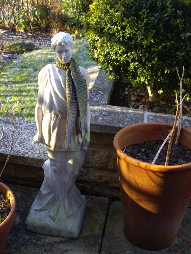 Hadrian's knitted scarf keeps him warm all year round!